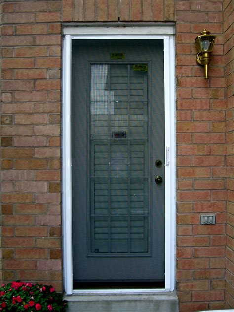 exterior faux brick panels with glass doors home
