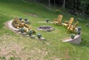 sloped yard bonfire pit garden landscape