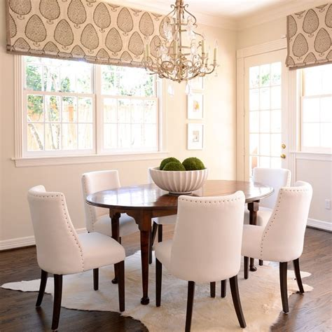 Metallic Cowhide Rug Oval Diningtable With White Dining Chairs Transitional