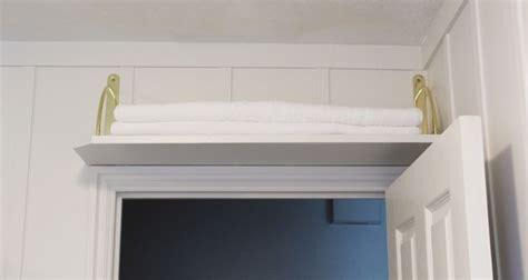 diy simple abovethedoor bathroom storage shelf