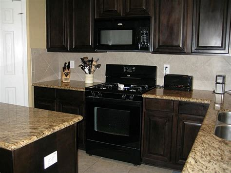 In the kitchen built in black microwave tile floors in kitchen