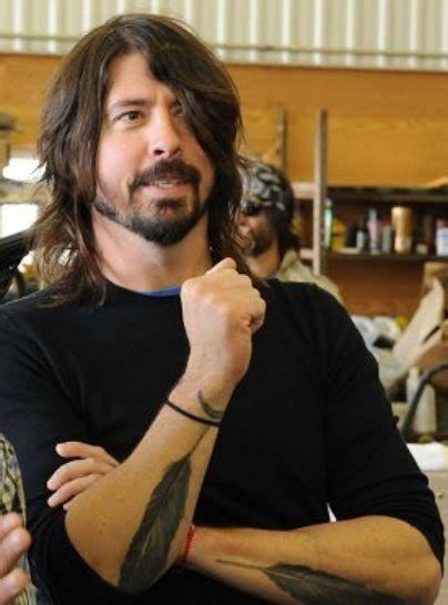 dave grohl feather tattoo to feel rhythm in silence a bit of resolve dave