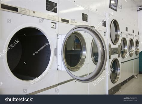 Laundry Mat Song by Rows Of Dryers At A Laundry Mat Stock Photo 54233599