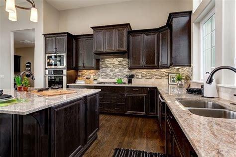 traditional kitchen  custom hood complex granite