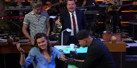 harry styles tattoo roulette watch harry styles get an unfortunate tattoo after losing