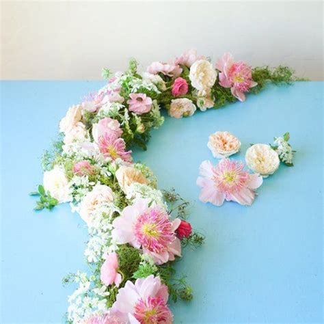 best 25 flower garlands ideas on pinterest paper flower garlands hanging paper flowers and