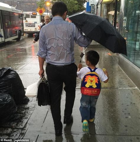 dad encourages son to be a man while getting shots father becomes internet sensation after using his umbrella