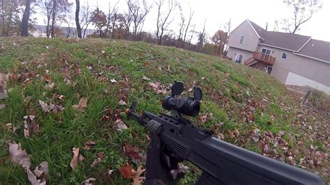 backyard airsoft wars 1v2 backyard airsoft war 2 cyma ak 47 youtube