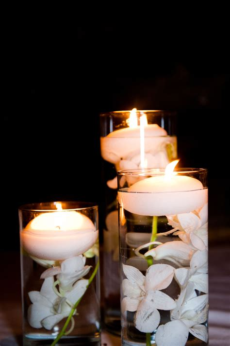 white floating candle table centerpieces neutral table