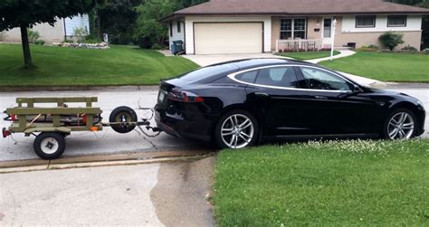 tesla model s tows a generator on a trailer video