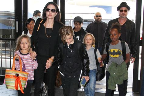 New Photo Of The Pitt Family by Brad Pitt And Their Six Fly Economy