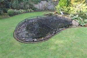 Piece child and animal safe pond cover with removable panel to acces