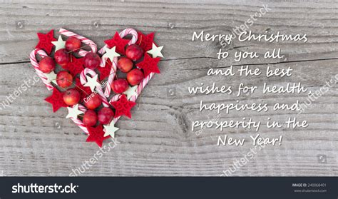 merry and all the best card with canes and apples merry
