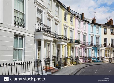 buying houses in london row of colorful london houses in primrose hill stock photo royalty free image
