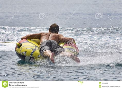 inner tube pulled by boat inner tubing fun stock photo image 13113230