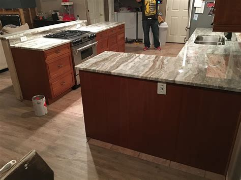 granite countertops with brown cabinets brown quartzite countertops by granite perfection
