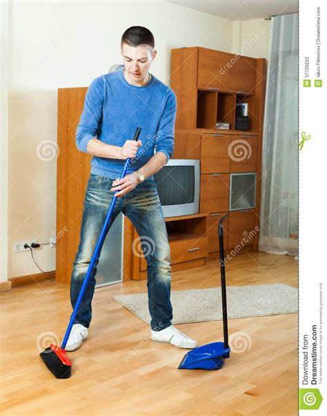 Sweeping Floor by Sweeping The Floor At Home Stock Photo Image 37729222