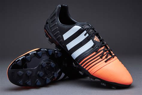 Sepatu Bola Adidas Nitrocharge 1 0 sepatu bola adidas nitrocharge 1 0 ag black white orange