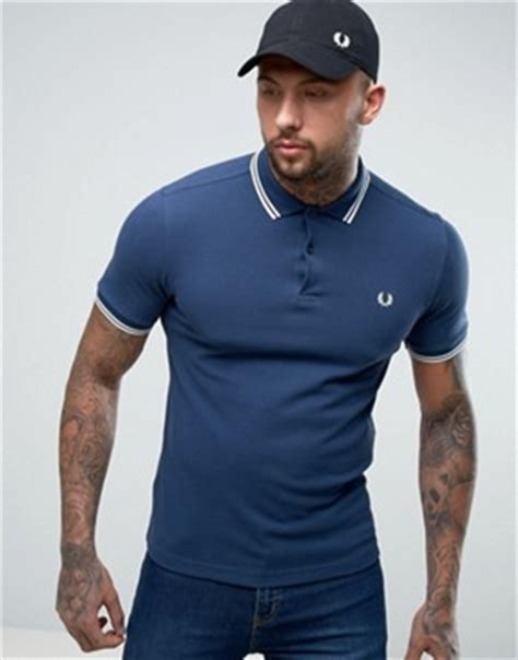 fred perry twin tipped fred perry inky blue girl polo fred perry shop men s polo shirts shirts t shirts asos