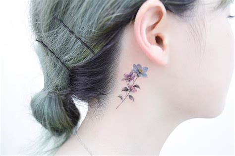 small flower tattoos behind ear 28 small tattoos every needs to get tattoomagz