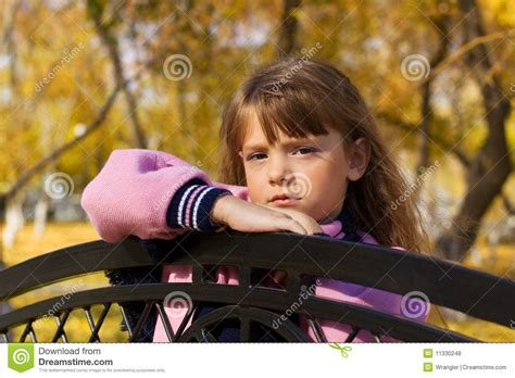 bench girl little girl on the bench royalty free stock photos image 11330248