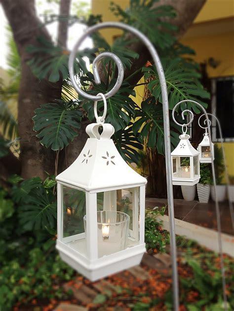 Hanging lanterns for aisle decor. Keywords: #pewbows #