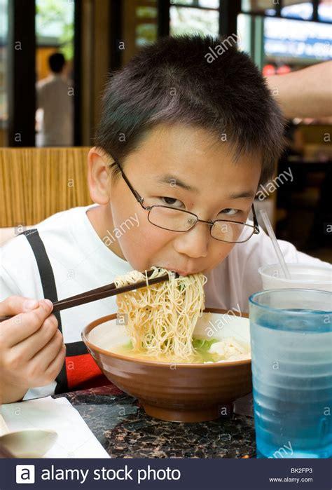 Ramen Eat boy ramen noodles and shrimp wonton soup with stock photo royalty free image