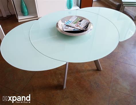 Amazing Coffee Table Transforms To Dining Table #6: Butterfly-round-glass-expanded-table-in-white-glass.jpg