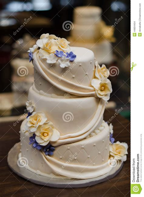 Wedding Cakes With Yellow And Purple Flowers by Three Tier Chagne Colored Wedding Cake With Yellow And