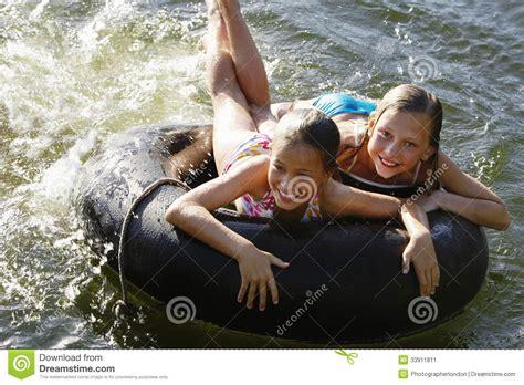 very young little girls underground girls lying on float tube at lake stock image image