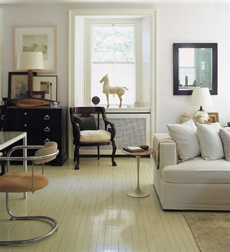 brightening your home with painted wood floors