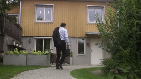 House Walking by Walking Towards A House Stock Footage 2642825