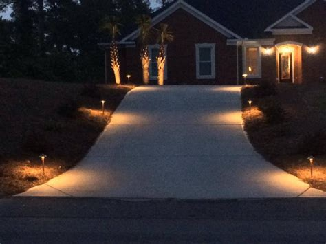 outdoor lighting makes a grand entrance in forest acres