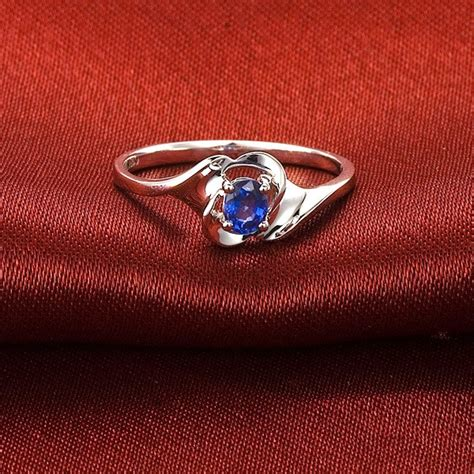 solitaire sapphire engagement ring on 10k white gold