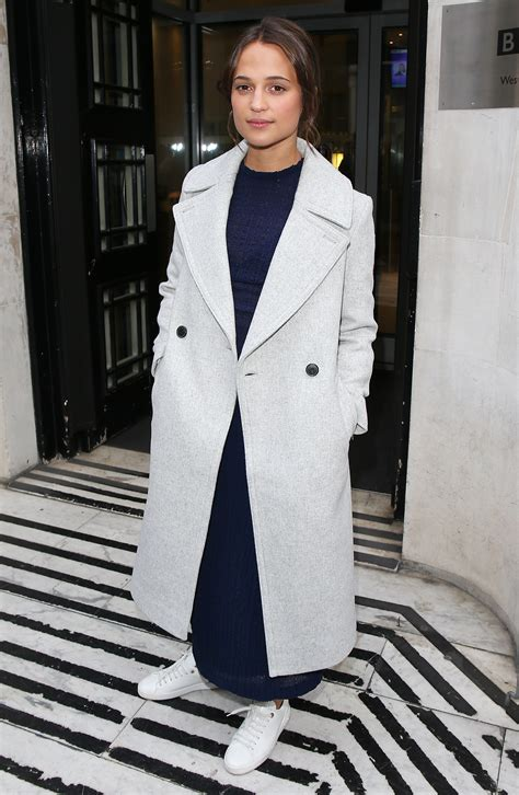 alicia vikander wears navy matching set  white sneakers