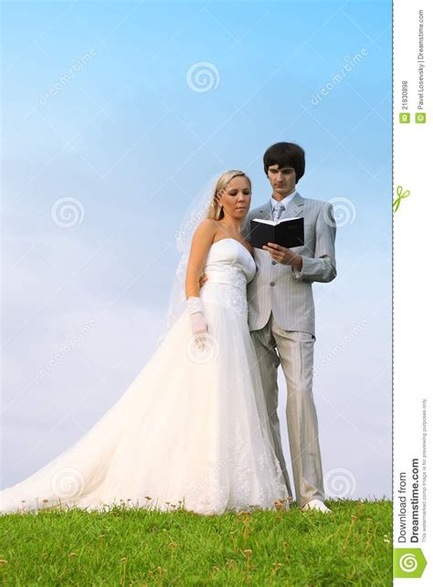 White Wedding Dress Bible by Groom And Read Bible Together Royalty Free Stock