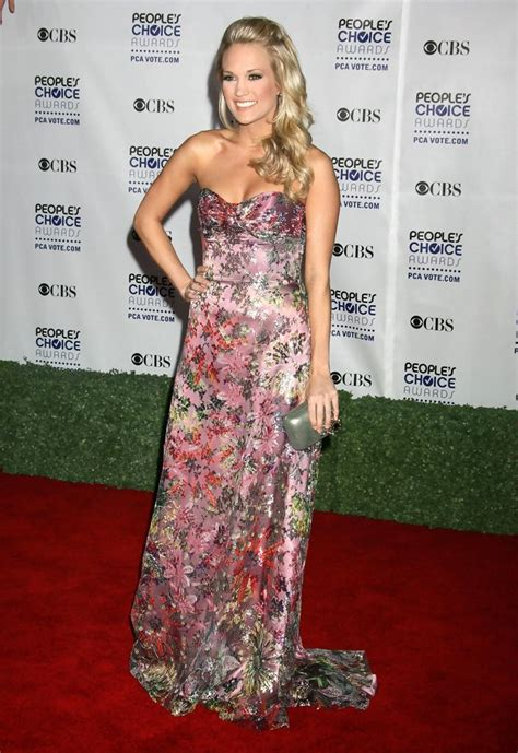 Carrie Underwood With Their Clutches by Carrie Underwood Metallic Clutch Carrie Underwood Looks