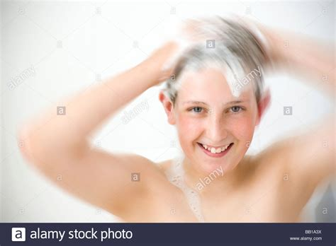 pretty verry young boys washing hairs verry young boys washing hairs boy shooing hair in