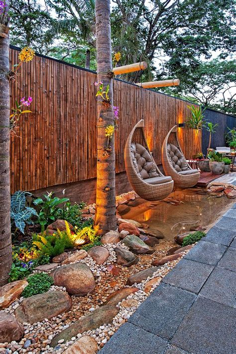nice formal landscaping design with brick pavers backyard