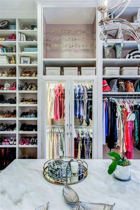 Shoe Closet With Doors Walk In Closet With Paneled Bi Fold Wardrobe Closet Doors Transitional Glass Front Wardrobe Cabinets With Custom Lighting Transitional Closet