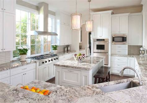 Stunning White Textured Granite Countertop For Classic White Kitchen Cabinets With Granite Countertops