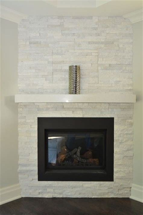 white fireplace with a black mantle in place of