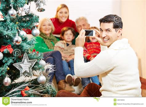 how to take a picture of a christmas tree taking family picture at stock photo image 46319934