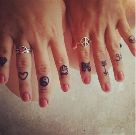 finger tattoos tumblr sea shell