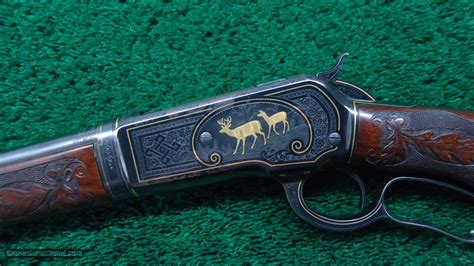 fantastic factory engraved gold inlaid winchester model
