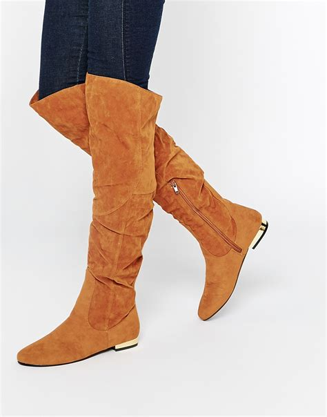 flat the knee boots in brown lyst