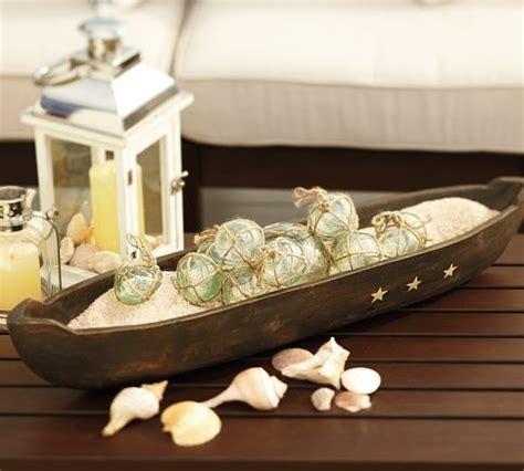Canoe Decor by Canoe With Glass Floats House Decorating Ideas