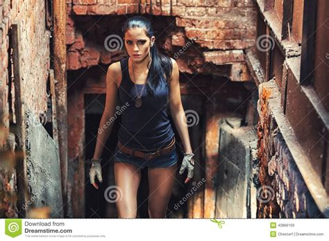 hot movie themes sexy soldier woman on factory ruins stock photo image