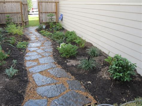 flagstone and decomposed granite path flanked by butterfly attracting plants owner wanted room