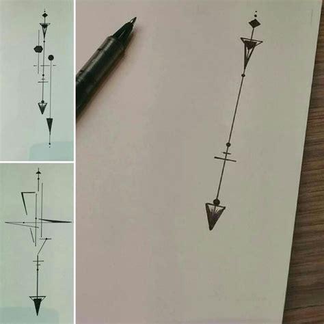 geometrical design off an arrow tattoo architecturale